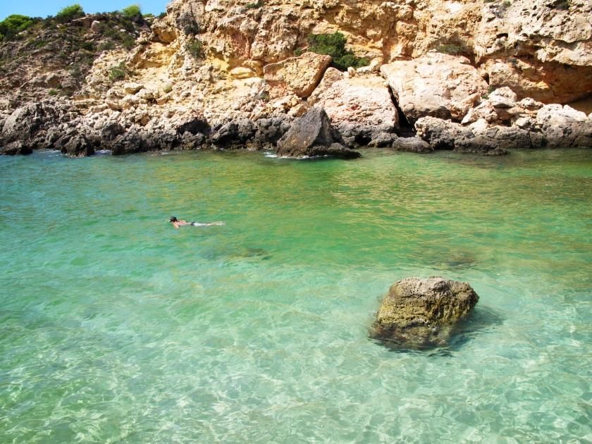 Snorkeling in Cala Tarida, Ibiza.