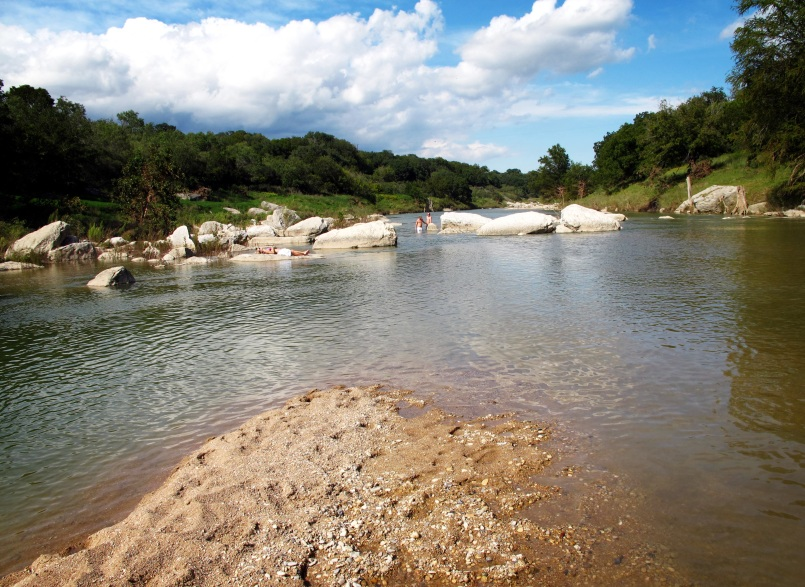 Wading near the rocks in the Pedernales River.