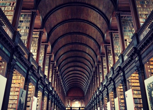 A wide view of the Long Room of Trinity College's Old Library.