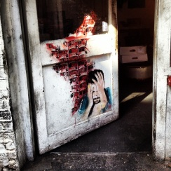 A door of despair along Brick Lane, London.