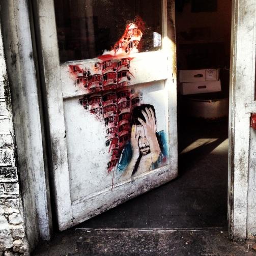 A door of despair along Brick Lane.
