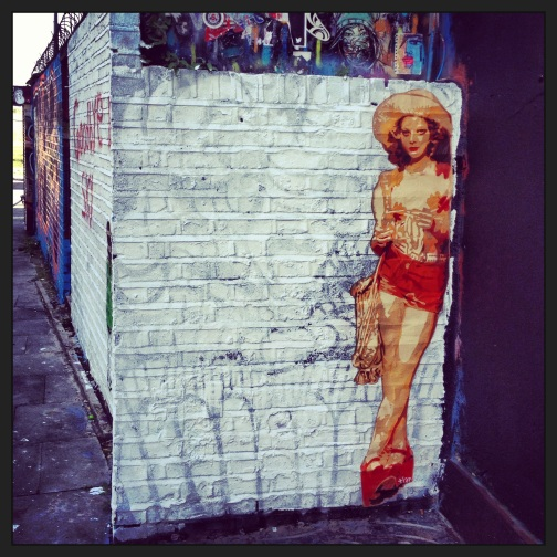 Jodi Foster on a street corner. Brick Lane.