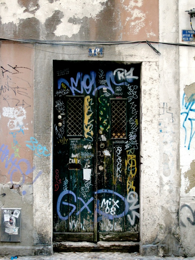 A tagged door in Lisbon, Portugal.