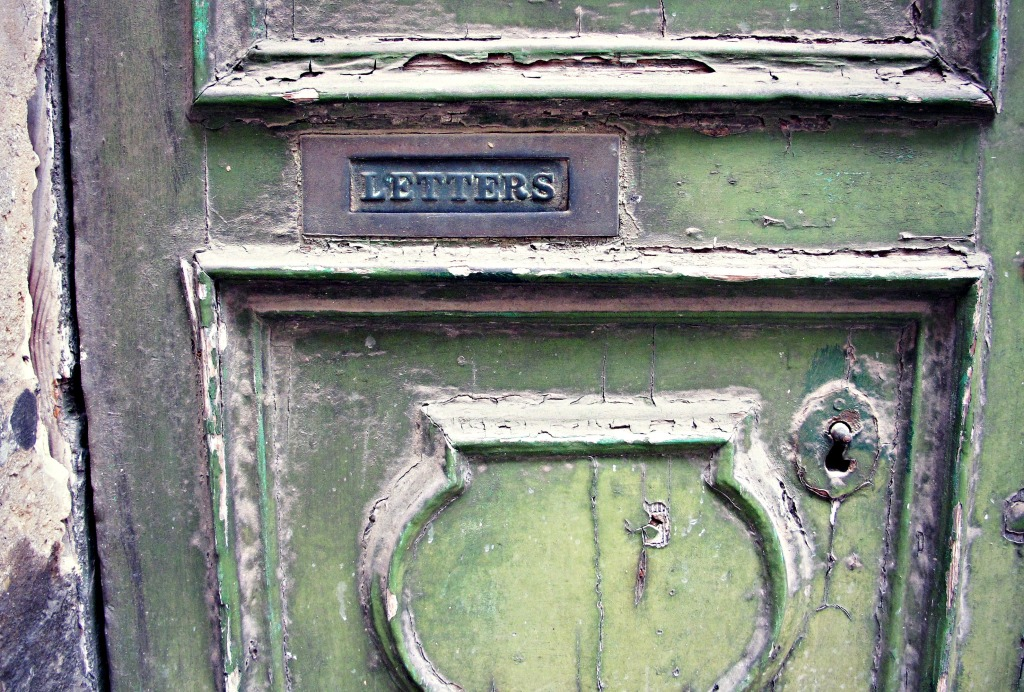 Letterbox on an old green door