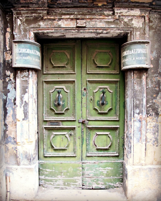 Old green door in Valletta, Malta.