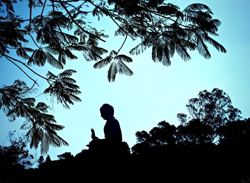 Silhouette of the Big Buddha from afar, on Lantau Island.