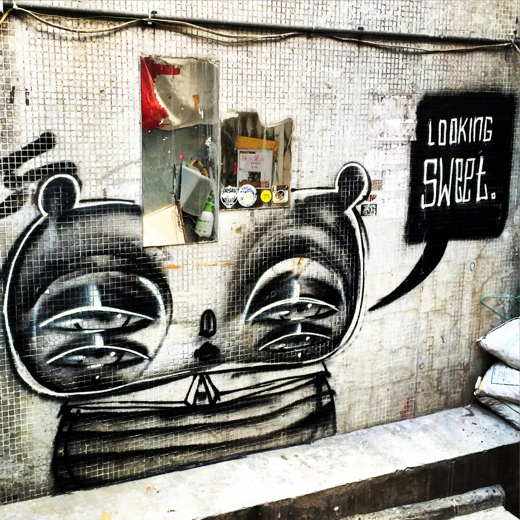 Mirror and street art on On Wo Lane in Sheung Wan.