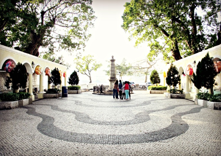 The leafy plaza in front of the Chapel of St. Francis Xavier.