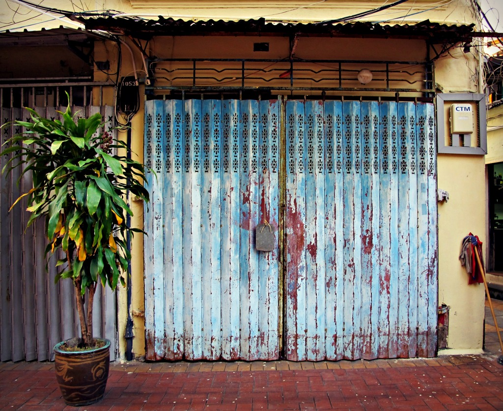 A closed storefront in the town of Coloane, Macau.