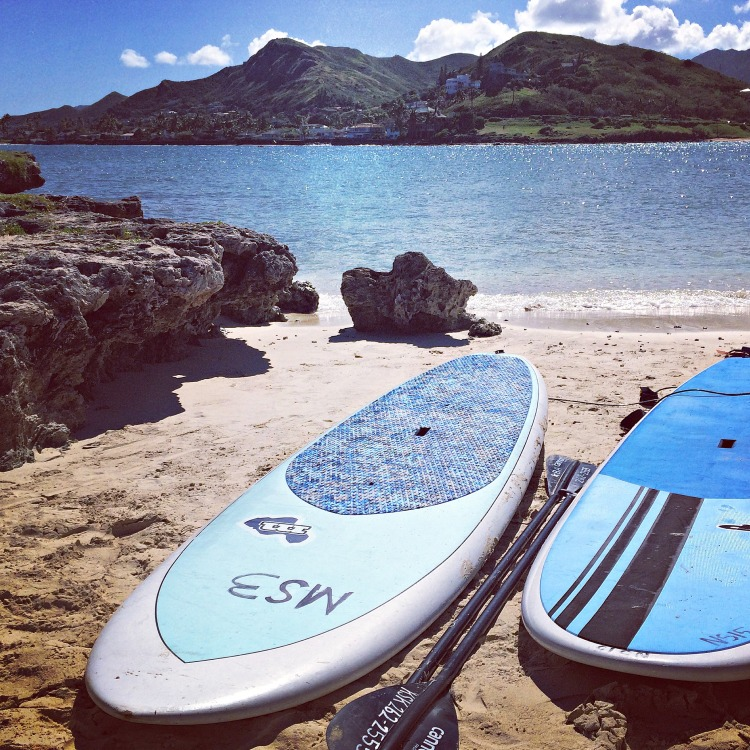 Our pair of paddleboards, on the shore of Flat Island. Lanikai Beach in the distance.
