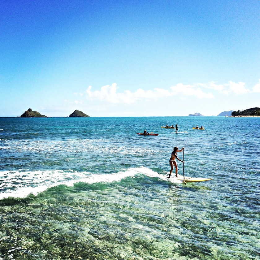 A stand-up paddleboarder just off Flat Island in Kailua.