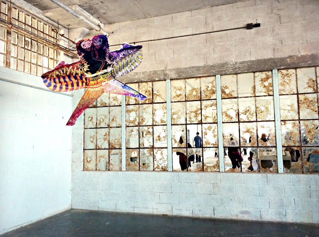"""A stylized kite in the corner of the """"With Wind"""" installation."""