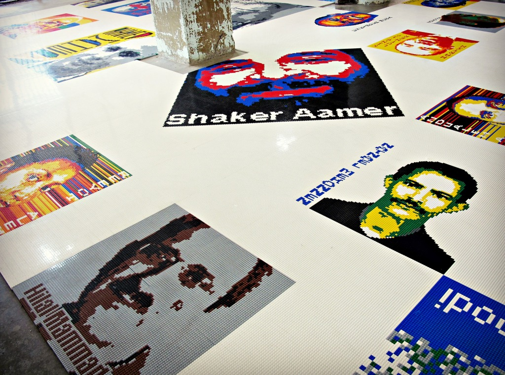 """A view of the """"Trace"""" installation, which displays portraits made of Lego bricks of people imprisoned all over the world. As noted in the informational binders, some of the activists have since been released."""