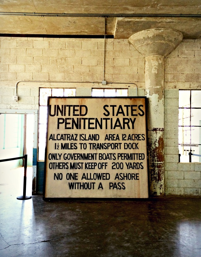 An Alcatraz sign, resting in the rear of the New Industries Building at the @Large exhibition.