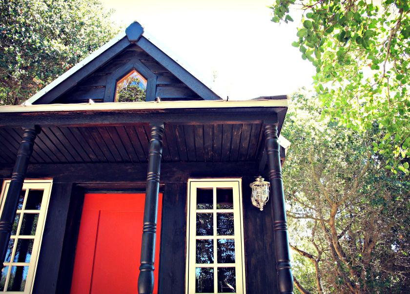 The tomato red door of my tiny house in Sonoma County, California.