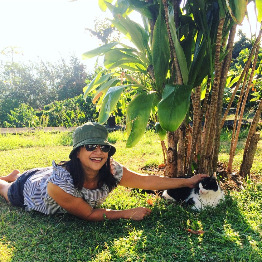 With Dazzle, the plantation's friendly resident cat.
