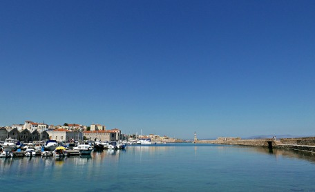 View of Chania's waterfront, with the Venetian lighthouse in the distance.