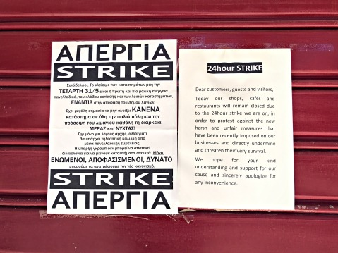 A notice on May 31, 2017, on the door of one of the shops on Chalidon Street. Nearly all businesses were closed due to a strike.